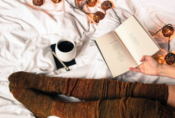 Cozy drinking coffee reading a book.