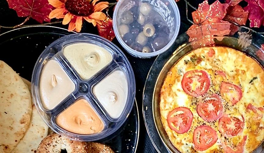 Quiche, hummus, warm olives, bagels, naan
