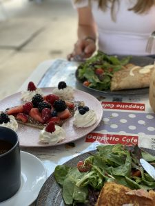 Geppetto Cafe mixed berry crepe, side salad, and prosciutto crepe