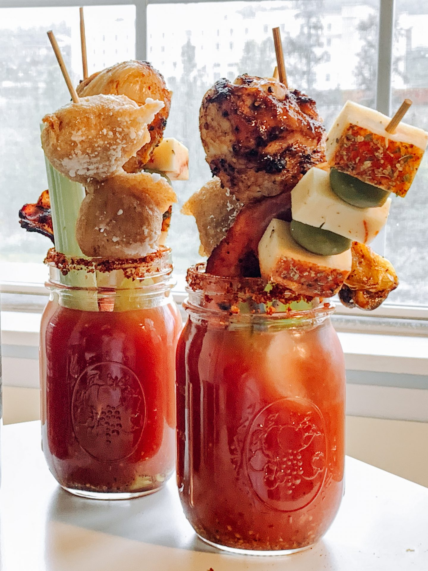 bloody mary with drumsticks, cheese, olives, bacon, and donuts