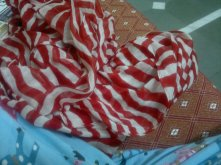 I like to call this the Waldo Scarf :) .. Buying this gave a pleasant end to my January!