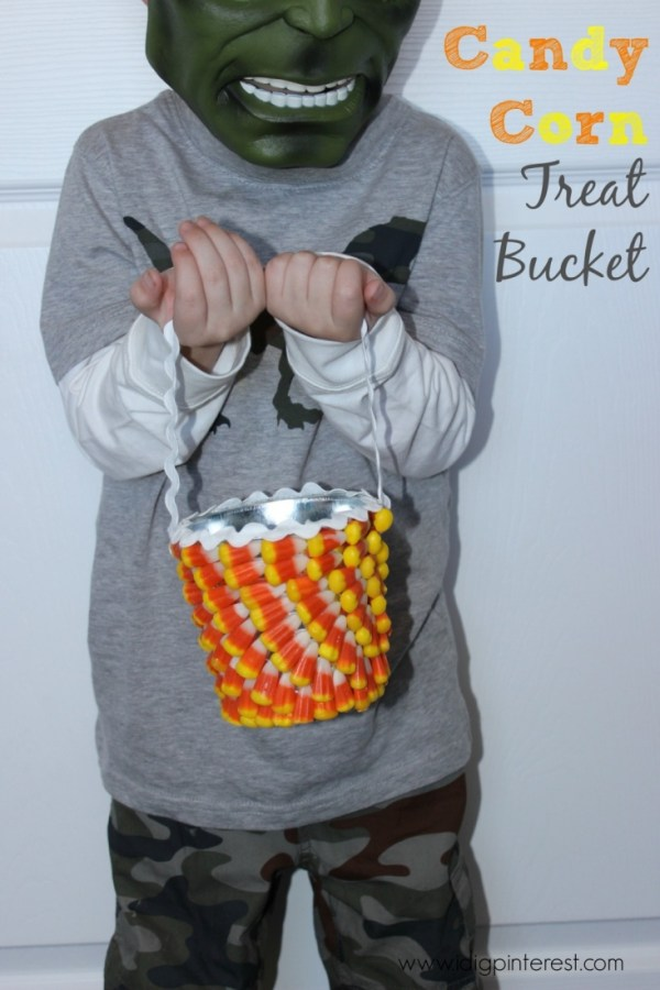 Make this super cute treat bucket out of a plain metal bucket and candy corn! #31DaysofHalloween