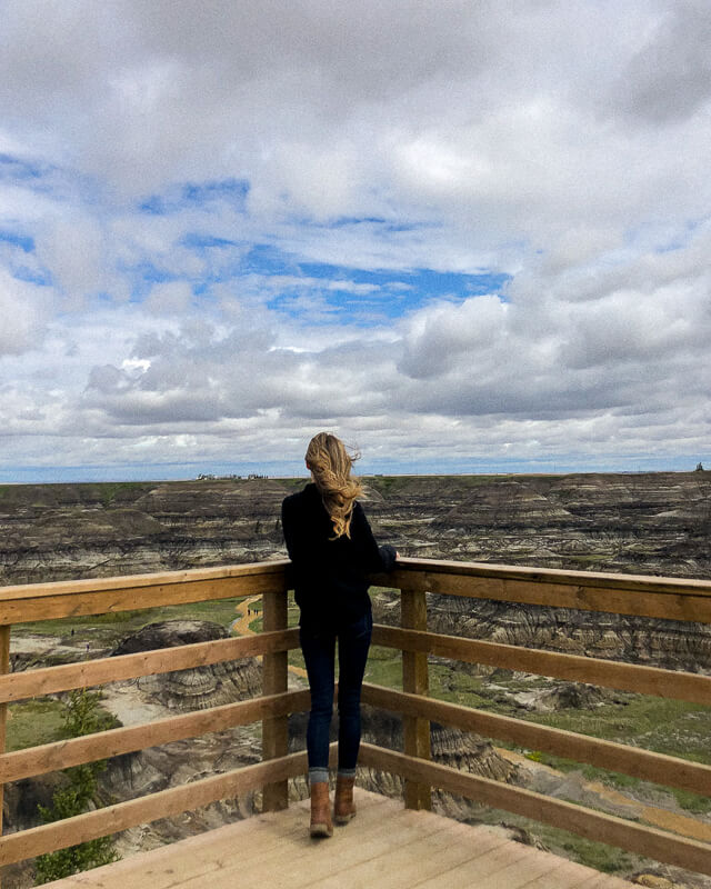 Girl Looking out at Horseshoe Canyon in Drumheller, Alberta
