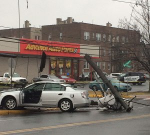 If you are in an accident, hit a utility pole and power lines fall on your car, what do you do?