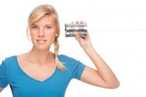 Girl using tin can as phone
