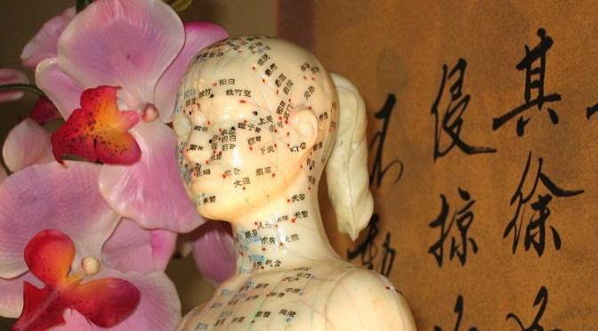 Massagen Akupunktur Statue