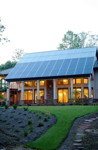 This North Carolina home gets most of its space heating from the passive solar design, but the solar thermal system (top of roof) supplies both domestic hot water and a secondary radiant floor heating system. | Photo courtesy of Jim Schmid Photography.<br />