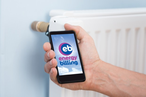 Person Hand Adjusting Temperature Of Thermostat Using Cellphone