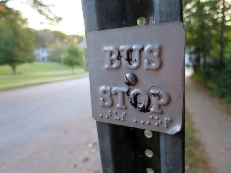 "A sign: ""Bus Stop"""