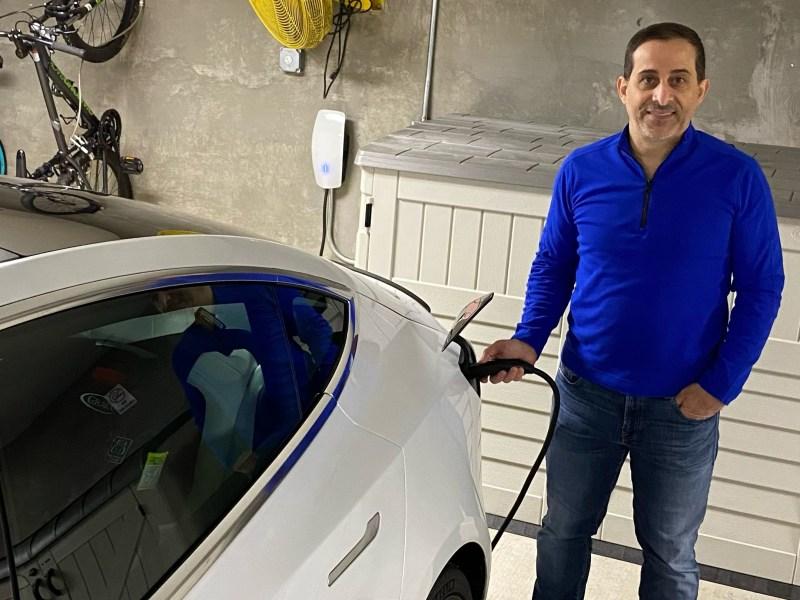 Wael Ali charging his Tesla in the garage of his Prince William, Virginia, condo.