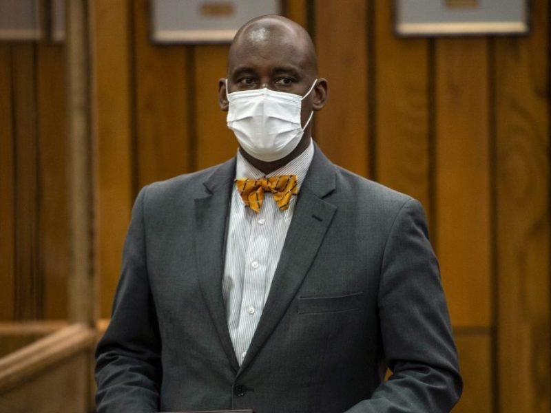 Van Turner, president of the NAACP Memphis Branch, wears a suit and a mask.