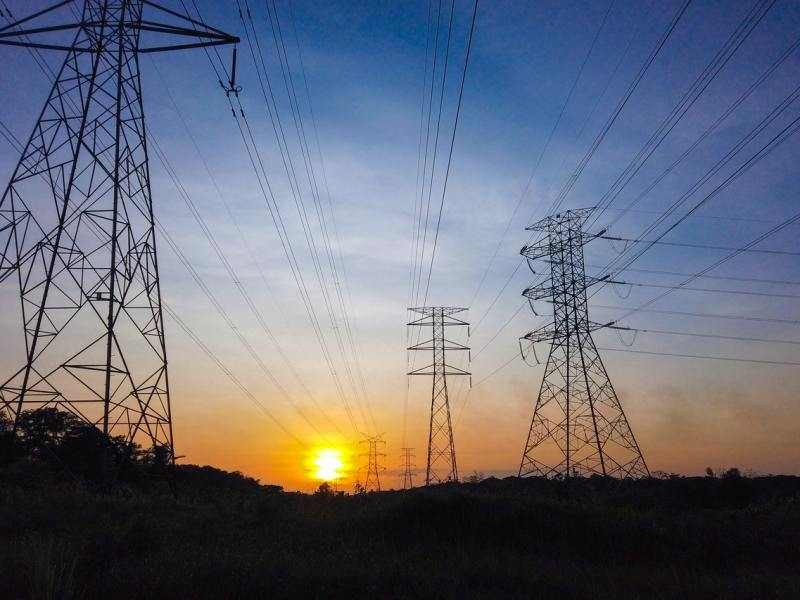 Silhouette of electric towers at sunset