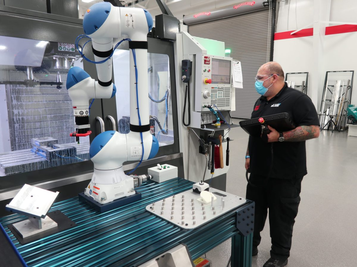 Mike Cepeda, an eKAMI instructor, with a state-of-the-art robot.