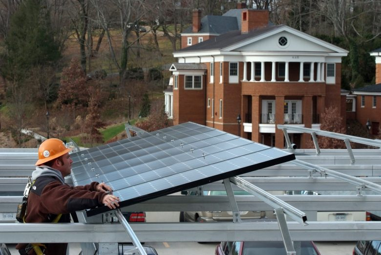 Workers install solar panels at Washington and Lee University in Lexington, Virginia.