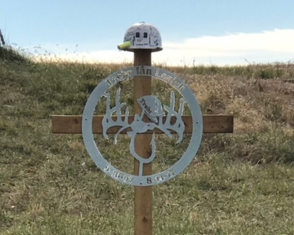 A roadside memorial for Trebr Lenich.