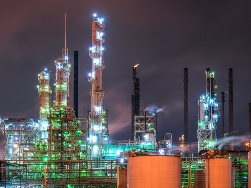 Smokestacks and rigging glow with lights in the night at the Baton Rouge oil refinery in Louisiana.