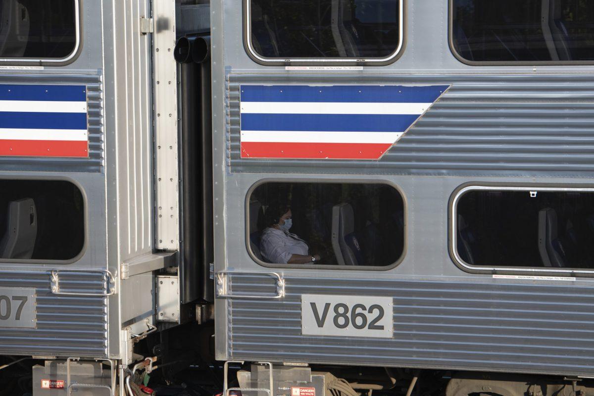 A passenger on a train near Washington, D.C., in fall 2020.