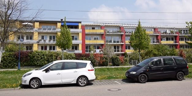 This long residential complex in Freiburg, Germany, is actually two separate buildings. Which one do you think is Passive House? The red one on the right side with the solar panels on top, or the yellow left half? If you can't tell the difference, join the club. (Answer: the Passive House section is the yellow part on the left.)