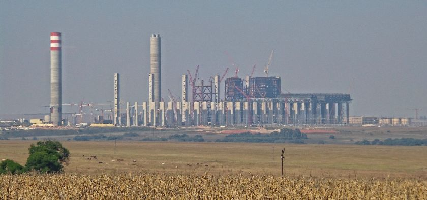 Behind something that looks like a cornfield there's the coal power plant Kusile.