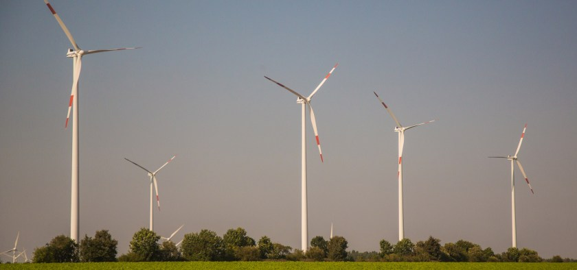Wind Turbines in a field (Photo taken somewhere along the DB Bahn ICE route from Hamburg to Berlin, Germany)