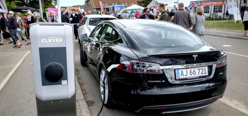 Black model S Tesla charging in a street in Denmark
