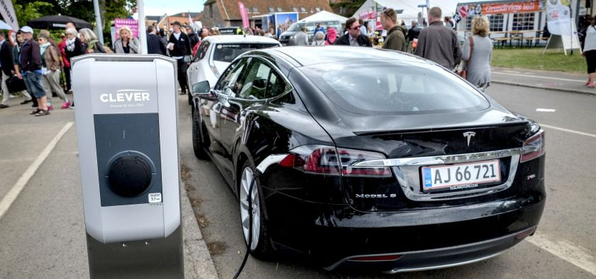 Black model S Tesla charging in a street in Denmark