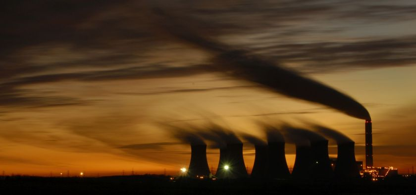 The towers of Cottam Power Station silhoutted against the sky at sunset