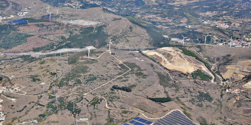 View from the air of Portugese countryside with solar panels and wind turbines