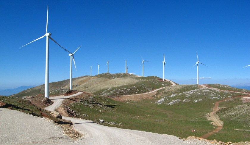view of turbines along the coastline in the Panachaiko Greece