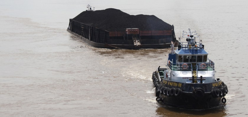 A barge from Samarinda coal mine on the Mahakam river, Indonesia