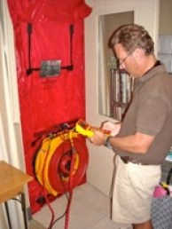 A Blower Door uses a pressure difference to measure the amount of air leakage in a home.