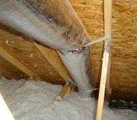 hvac duct against roof deck outside building envelope