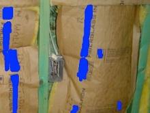 Grade III installation of fiberglass batt insulation