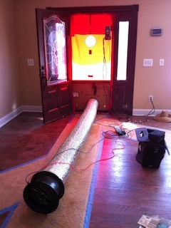 Doing a blower door test on a tight house with a Duct Blaster fan
