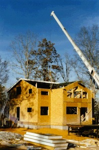 SIP structural insulated panels being installed in roof