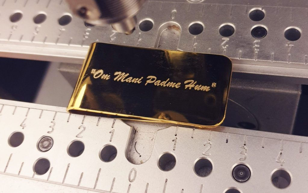 Money Clip being Engraved