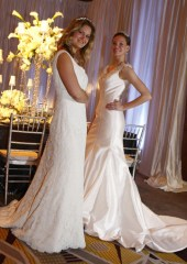 © Ricky Flores. From left, Models Cami Shore and Mary Dannegger show off an Elenzon Lace, off the shoulder fitted dress with a chaple train, left, and a mikado silk off the shoulder, fitted and flared trumpet bubble bottom train from Fontana Bridal in Scarsdale at The Ritz-Carlton Something Blue bridal show in White Plains February 22, 2009 (Ricky Flores /The Journal News)