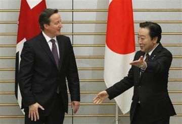 Japan's Prime Minister Noda welcomes his British counterpart David Cameron as they meet at Noda's official residence in Tokyo