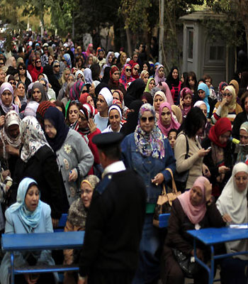 Egyptians narrowly back constitution, say rival camps