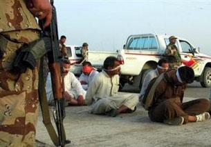 Military Investigates U.S. Guards in Iraq