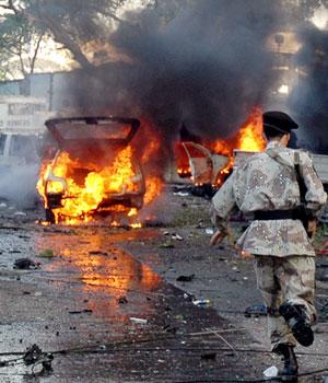 Bombing near U.S. consulate kills four, including U.S. diplomat, ahead of Bush visit to Pakistan