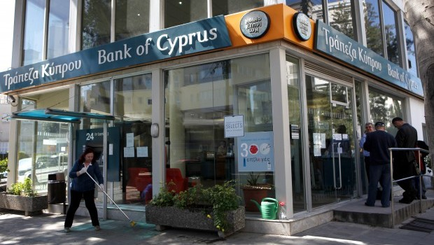 Cyprus Reopens Banks Under Tight Restrictions