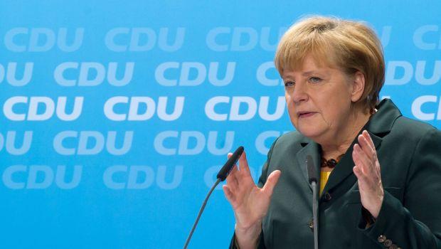 Merkel's conservatives back coalition deal despite doubts