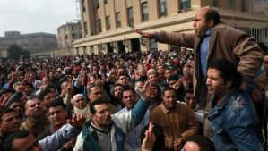 In this photo taken on Saturday, February 15, 2014, textile workers strike to demand a minimum wage, the removal of their company's head and the head of the firm's holding company, and back pay of yearly bonuses in Mahalla, Egypt. (AP Photo/Sabry Khaled)