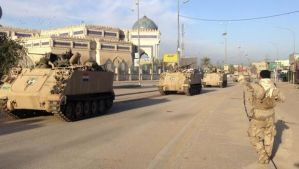 A convoy of Iraqi security forces' armored vehicles moves along during clashes with Al-Qaeda-affiliated Islamic State in Iraq and Syria (ISIS) in Anbar province, Iraq, on February 1, 2014. (Reuters/Stringer)