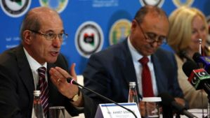 Ahmet Üzümcü, left, director of the OPCW, speaks during a press conference in Tripoli, Libya on February 4, 2014. (AFP Photo/Mahmud Turkia)