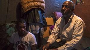 Mabruk Medewesi (R) in the Tripoli camp. (Asharq Al-Awsat/Hannah Lucinda Smith)