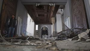 Damages are seen inside the Museum of Islamic Art as members of the UNESCO delegation assess the damage to the museum in Cairo, Egypt, on Friday, January 31, 2014. (AP Photo/Hassan Ammar)