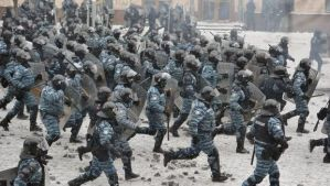 A file picture dated January 22, 2014 shows members of the Ukrainian riot police unit, the Berkut, attacking protesters during an anti-government protest in downtown Kiev. (EPA/Alexei Furman)