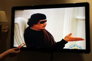 A picture taken in Gaza city on May 11, 2011, shows Libyan state TV showing footage of strongman Muammar Gaddafi in a meeting. (Mahmud Turkia/AFP/Getty)